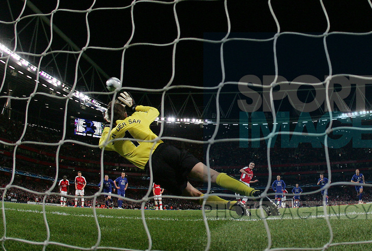 Arsenal's Robin Van Persie scoring from the penalty spot