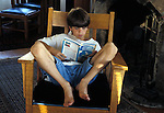 Berkeley CA Boy, age 9, reading at home
