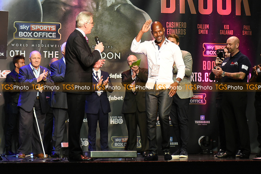 Former professional boxer Bernard Hopkins (white shirt) waves to the crowd during a Weigh-In at the O2 Arena on 9th September 2016