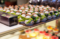 Confections in the shape of snowmen fill a glass display case at a Paris cake shop in December.