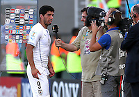 Luis Suarez of Uruguay is interviewed by TV at the final whistle