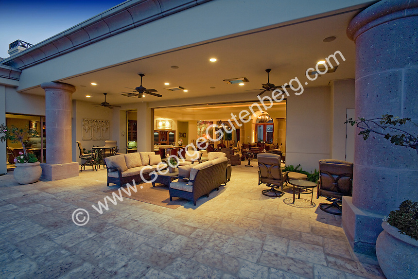 View of outdoor living area with furniture and view inside through open pocket doors