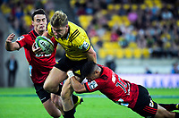 Jordie Barrett is tackled during the Super Rugby match between the Hurricanes and Crusaders at Westpac Stadium in Wellington, New Zealand on Friday, 29 March 2019. Photo: Dave Lintott / lintottphoto.co.nz
