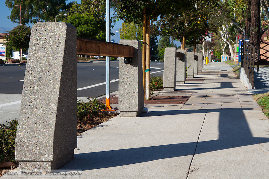 "Parkway features of the northeastern portion of the Grand and Diamond Bar intersection - large wooden beams, trees with iron grates, and colored concrete. This was part of the 2015 rebuild of the Grand Avenue and Diamond Bar Boulevard intersection for Diamond Bar's 2015 ""Grand Avenue Beautification"" project, landscape architecture for the project was by David Volz Design."
