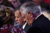 United States Secretary of State Rex Tillerson (R) Jordan's King Abdullah (C) listen to remarks at the National Prayer Breakfast where U.S. President Donald Trump spoke February 2, 2017 in Washington, DC. Every U.S. president since Dwight Eisenhower has addressed the annual event.  <br /> Credit: Win McNamee / Pool via CNP