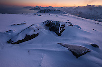 Winter dawn over mountain landscape from summit of Ryten, Moskenesøy, Lofoten Islands, Norway