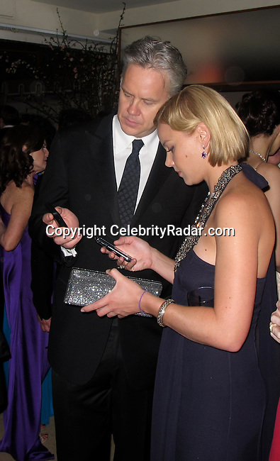 **EXCLUSIVE**.Tim Robbins getting a lady's phone number..Vanity Fair Oscar Party..Sunset Tower Hotel..Hollywood, CA, USA..Sunday, March 07, 2010..Photo By CelebrityRadar.com.To license this image please call (212) 410 5354; or Email: CelebrityRadar10@gmail.com ; .website: www.CelebrityRadar.com.