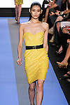 Ming walks runway in a cadmium yellow sequin strapless corset seamed cocktail dress, by Monique Lhuillier, from the Monique Lhuillier Spring 2012 collection fashion show, during Mercedes-Benz Fashion Week Spring 2012.