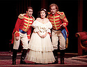 1999 - DAUGHTER OF THE REGIMENT - L-R - John Osborn as Tonio, Lynette Tapia as Marie, and Kristopher Irmiter as Sargent Sulpice after Maries music lesson and after the soldiers invade the salon in Act 2 of Opera Pacifics performance 'Daughter of the Regiment'.