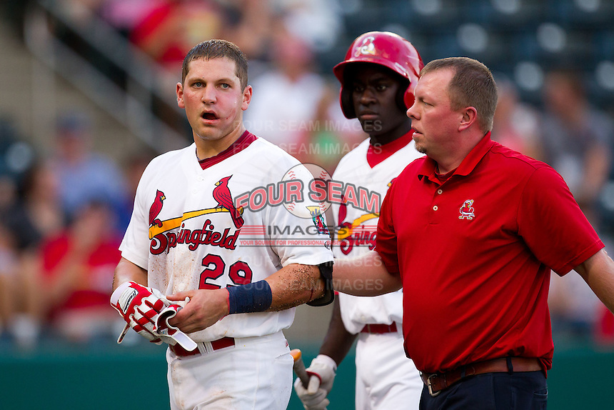 Travis Tartamella (29) of the Springfield Cardinals walks back to the dugout after being hit in the face by a pitch during a game against the Arkansas Travelers at Hammons Field on July 25, 2012 in Springfield, Missouri. (David Welker/Four Seam Images)