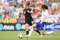 14 MAY 2011: USA Women's National Team midfielder Carli Lloyd (10) and Japan National team Saki Kumagai during the International Friendly soccer match between Japan WNT vs USA WNT at Crew Stadium in Columbus, Ohio.
