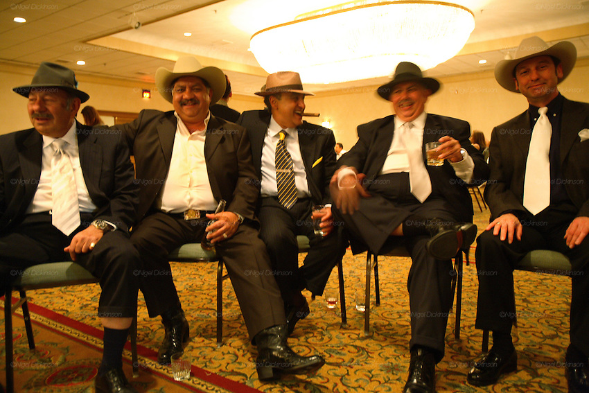Dukey and his peers dressed up for an Orthodox pumana, a ceremony celebrating the life of a family member who died, six month after his funeral. Kalderash Roma, whose forefathers travelled to the United States after being liberated from slavery during the mid nineteenth century in Romania. A Dallas hotel, Texas USA 2006.