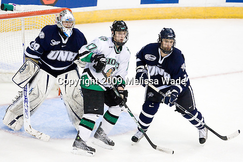 Brian Foster (UNH - 29), Jason Gregoire (UND - 17), Jamie Fritsch (UNH - 2) - The University of New Hampshire Wildcats defeated the University of North Dakota Fighting Sioux 6-5 (OT) in the 2009 Northeast Regional semifinal on Saturday, March 28, 2009, at the Verizon Wireless Center in Manchester, New Hampshire.