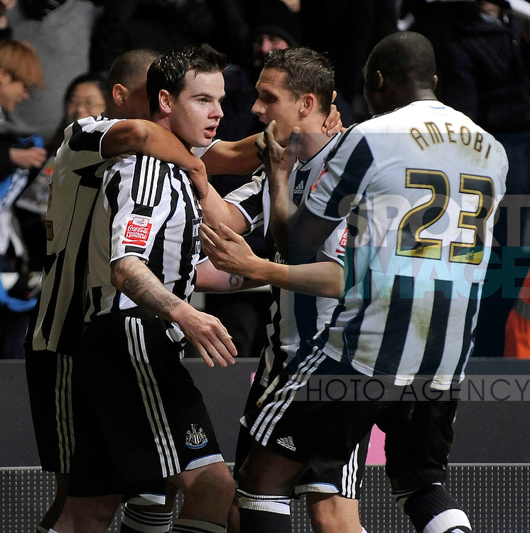 Newcastle's Danny Guthrie celebrate his goal with team mates.