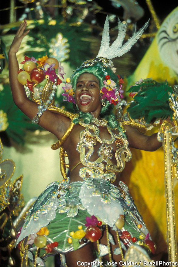 Black beautiful young woman wearing colorful costume dressed up as Carmen Miranda, Samba Schools Parade, Rio de Janeiro Carnival, Brazil.