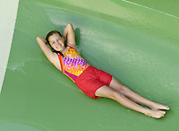 NWA Democrat-Gazette/BEN GOFF @NWABENGOFF<br /> Trulie Nichols, 12, of Springdale takes a turn on a water slide on Sunday Sept. 6, 2015 at the Rogers Aquatic Center. The water park will be open for the last day of the 2015 season on Monday from 11:00a.m. to 7:00p.m.