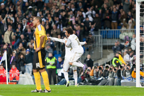 28.01.2012 Madrid, Spain,Real Madrids Cristiano Ronaldo and Marcelo celebrates the goal during the Spanish league game between Real Madrid and Real Zaragoza at the Santiago Bernabeu Stadium.