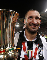 Calcio, finale Tim Cup: Juventus vs Lazio. Roma, stadio Olimpico, 20 maggio 2015.<br /> Juventus' Giorgio Chiellini holds the trophy at the end of the Italian Cup final football match between Juventus and Lazio at Rome's Olympic stadium, 20 May 2015. Juventus won 2-1 after extra time.<br /> UPDATE IMAGES PRESS/Isabella Bonotto