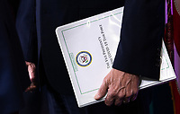 United States Vice President Mike Pence holds a binder as he attends a Coronavirus briefing with US President Donald J. Trump and members of the Coronavirus Task Force in the Brady Press Briefing Room at the White House in Washington, DC, March 17, 2020, in Washington, D.C. <br /> Credit: Kevin Dietsch / Pool via CNP/AdMedia