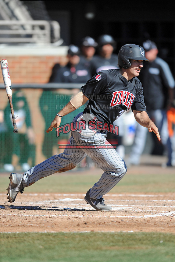 UNLV Runnin' Rebels catcher Craig Shul #31 swings at a pitch during a game against the Tennessee Volunteers at Lindsey Nelson Stadium on February 22, 2014 in Knoxville, Tennessee. The Volunteers defeated the Rebels 5-4. (Tony Farlow/Four Seam Images)