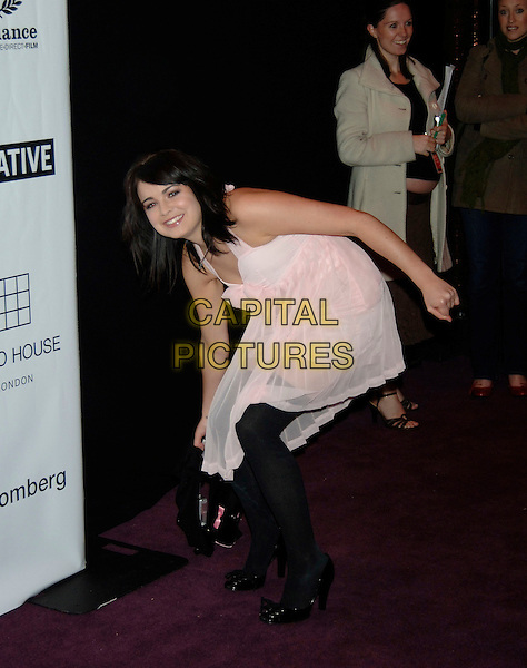 EMILY BARCLAY.The British Independent Film Awards at Hammersmith Palais, London, UK..November 30th, 2005.Ref: PL.full length pink sheer dress leaning.www.capitalpictures.com.sales@capitalpictures.com.©Capital Pictures