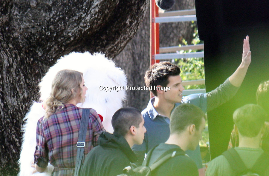 ....12-3-09.Thursday Exclusive ..Taylor Swift filming her new music video with boyfriend Taylor Lautner.  They were flirting & hugging the whole time during filming Taylors music video shoot. The couple looked as if they were really in love. The video was shot in westwood california at a University High School. During one of the scenes in the music video Taylor is holding a giant white teddy bear with a red nose & ribbon. The couple also took pictures with fans & signed autographs. ...AbilityFilms@yahoo.com.805-427-3519.www.AbilityFilms.com.