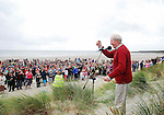 John 'Twin' McNamara salutes the crowd of tin whistle players that gathered on Keel strand, Achill on saturday for the world record attempt. The ensemble estimated to be around 1050 played the tune 'Fainne Geal an Lae' on Achill's longest beach and was part of the Scoil Acla celebrations that took place over the past week...Pic Conor McKeown