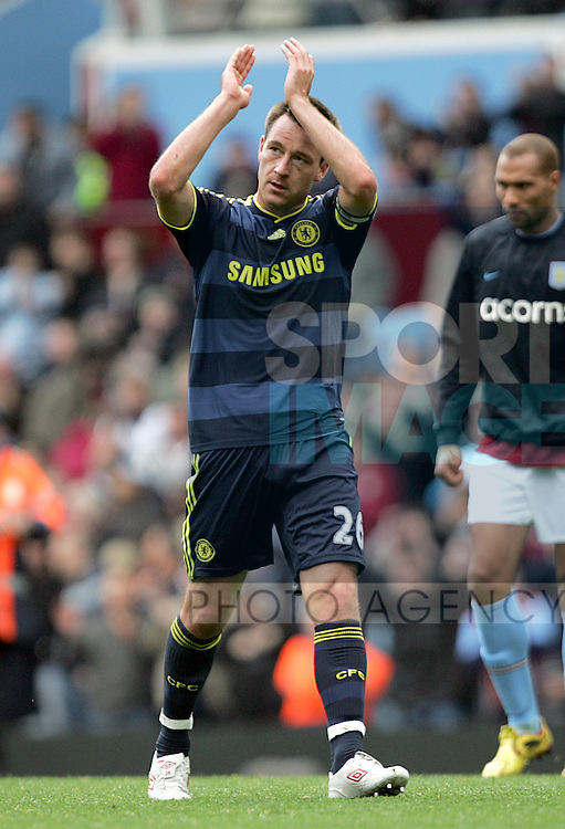A dejected John Terry of Chelsea applauds the away fans after the final whistle