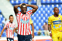 BARRANQUILLA -COLOMBIA- 18-08-2013. Edinson Toloza de Atletico Junior se lamenta al perder como local 0-1 ante Deportivo Pasto en partido correspondiente a la cuarta fecha de La  Liga Postobon II 2013 disputado en el estadio  Metropolitano de la ciudad de Barranquilla./ Atletico Junior player Edinson Toloza regrets after losing as a local 0-1 with Deportivo Pasto in match valid for the fourth date of the Postobon League II 2013 at Metropolitan Stadium in Barranquilla city. Photo: VizzorImage / Alfonso Cervantes  / Str