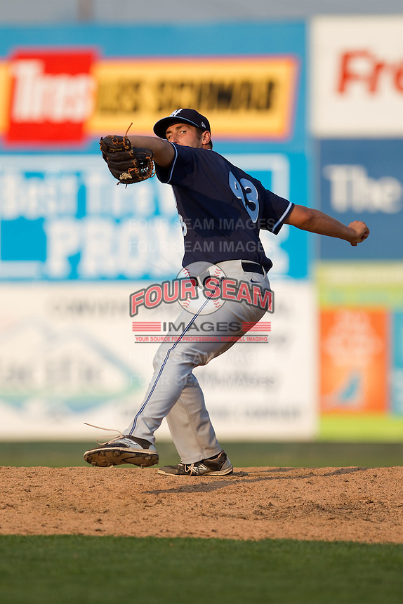 Joey Donino (43) of the Hillsboro Hops delivers a pitch during a game against the Everett Aquasox at Everett Memorial Stadium in Everett, Washington on July 5, 2015.  Hillsboro defeated Everett 11-4. (Ronnie Allen/Four Seam Images)