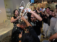 Jacksonville Suns Players, including Ryan Rieger (beard) and Collin Cargill (goggles) celebrate in the locker room pouring beer over coach John Duffy after clinching the Southern League Championship Series against the Chattanooga Lookouts on September 12, 2014 at Bragan Field in Jacksonville, Florida.  Jacksonville defeated Chattanooga 6-1 to sweep three games to none.  (Mike Janes/Four Seam Images)