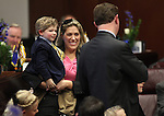 Nevada Sen. Ben Kieckhefer, R-Reno, acknowledges his wife April and their children during the opening day of the 77th Legislative Session in Carson City, Nev. on Monday, Feb. 4, 2013. <br />