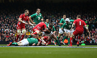 Pictured: Jamie Roberts of Wales (with ball) having just been brought down by Sean O'Brien of Ireland, while Samson Lee of Wales (3) pushes Jack McGrath of Ireland away Saturday 14 March 2015<br />