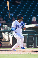 Surprise Saguaros designated hitter Meibrys Viloria (9), of the Kansas City Royals organization, releases the bat on his follow through during an Arizona Fall League game against the Salt River Rafters on October 9, 2018 at Surprise Stadium in Surprise, Arizona. Salt River defeated Surprise 10-8. (Zachary Lucy/Four Seam Images)