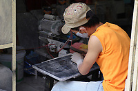 Hanoi<br /> , Vietnam - 2007 File Photo -<br /> A man engrave chinese ideograms.<br /> <br /> <br /> <br /> <br /> <br /> photo : James Wong-  Images Distribution