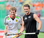 The Hague, Netherlands, June 08: Jan Philipp Rabente #14 of Germany and Shea McAleese #25 of New Zealand look on during the field hockey group match (Men - Group B) between the Black Sticks of New Zealand and Germany on June 8, 2014 during the World Cup 2014 at Kyocera Stadium in The Hague, Netherlands. Final score 3-5 (1-3) (Photo by Dirk Markgraf / www.265-images.com) *** Local caption ***