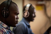 Eye Radio broadcast journalists gather news from their Juba station newsroom in South Sudan. In an effort to build up media and encourage a free media, USAID funded the station which is run by Internews.