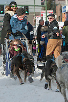 James Volek and team leave the ceremonial start line with an Iditarider at 4th Avenue and D Street in downtown Anchorage, Alaska on Saturday, March 5th during the 2016 Iditarod race. Photo by Joshua Borough/SchultzPhoto.com