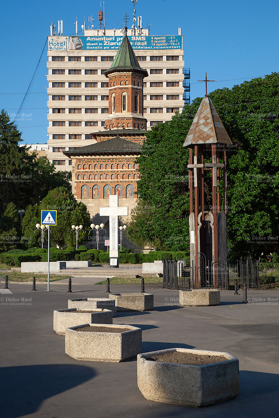 Romania. Iași County. Iasi. Architectural contrast. The white cross and the wooden construction on the foreground are both memorials for the freedom martyrs who died during the december 1989 romanian revolotion. The orthodox church in the center is the Biserica Sfântul Nicolae Domnesc. In the background, the tourist hotel Moldova was built during the communist time. Iași (also referred to as Iasi, Jassy or Iassy) is the largest city in eastern Romania and the seat of Iași County. Located in the Moldavia region, Iași has traditionally been one of the leading centres of Romanian social, and cultural life. The city was the capital of the Principality of Moldavia from 1564 to 1859, then of the United Principalities from 1859 to 1862, and the capital of Romania from 1916 to 1918. 8.06.15 © 2015 Didier Ruef