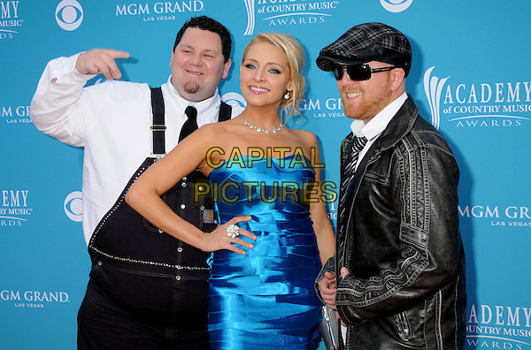 TRAILER CHOIR - Vinny Hickerson, Crystal Hoyt & Mark Fortney.45th Annual Academy Of Country Music Awards held at the MGM Grand Garden Arena, Las Vegas, NV, USA..April 18th, 2010.half length white black leather overalls dungarees blue silk satin hand on hip jacket strapless hat sunglasses shades .CAP/ADM/BP.©Byron Purvis/AdMedia/Capital Pictures.