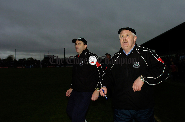 Anxious moments for Clarecastle's Ger O Loughlin and John O Flynn in the closing stages of the county final. Photograph by John Kelly.