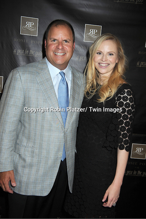 Stuart Leibach, VP of the stores, and Rosie Pope makes a  personal appearance to debut the Rosie Pope collection for A Pea in the Pod at the Destination Maternity Store in New York City on June 28, 2012.