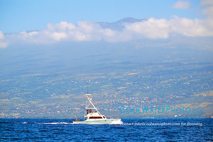 sport fishing boat, .trolling in front of Hualalai mountain, .Kona, Big Island, Hawaii (Pacific).