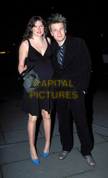JAMIE & JOOLS OLIVER.at the Restaurant Awards.turquoise, bright, pregnant, chef, blue heels, shoes.Ref: AH.www.capitalpictures.com.sales@capitalpictures.com.©Capital Pictures.