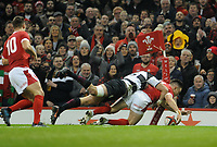 Wales Josh Adams scores his sides first try<br /> <br /> Photographer Ian Cook/CameraSport<br /> <br /> 2019 Autumn Internationals - Wales v Barbarians - Saturday 30th November 2019 - Principality Stadium - Cardifff<br /> <br /> World Copyright © 2019 CameraSport. All rights reserved. 43 Linden Ave. Countesthorpe. Leicester. England. LE8 5PG - Tel: +44 (0) 116 277 4147 - admin@camerasport.com - www.camerasport.com