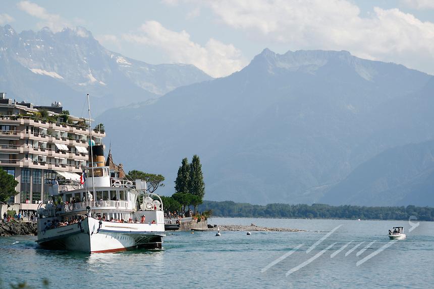 Touristic sea cruise.  Tourists on a boat cruising around the mountains of switzerland.