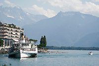 Touristic sea cruise.  Tourists on a boat cruising around the mountains of switzerland.