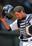 15 July 2010: Vermont Lake Monsters' catcher Wilfri Pena outside the dugout during a game against the Aberdeen IronBirds at Centennial Field in Burlington, Vermont. The Lake Monsters rallied in the bottom of the 9th inning to defeat the IronBirds 7-6 notching their league leading 20th win of the 2010 NY Penn League season. Mandatory Credit: Ed Wolfstein Photo