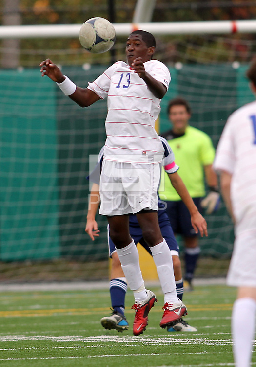 HYATTSVILLE, MD - OCTOBER 26, 2012:  Arion Sobers-Assue (13) of DeMatha Catholic High School pulls in a high ball against  St. Albans during a match at Heurich Field in Hyattsville, MD. on October 26. DeMatha won 2-0.