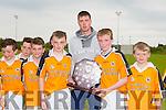 Jimí Ó Súilleabáin agus Tomás Ó Hainiféin captains of Gaelscoil Mhic Easmainn were presented with the shield by Shane Nolan after their team won their final at the Cumann na mBunscol Hurling finals at Abbeydorney GAA on Thursday